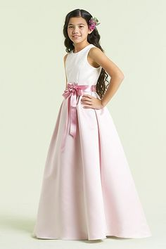 Duchess satin flower girl dress with sleeveless bodice, full skirt, and satin ribbon at waist with ribbon flower pin.