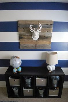 Stripes, reclaimed wood, faux animal head