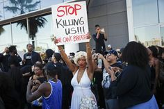 Marilyn Monroe impersonator April Q. Russell joins demonstrators protesting against police violence, including the July chokehold death of unarmed black man Eric Garner in New York, as they march near the area where LAPD shot an assault suspect, in Hollywood, California December 6, 2014.