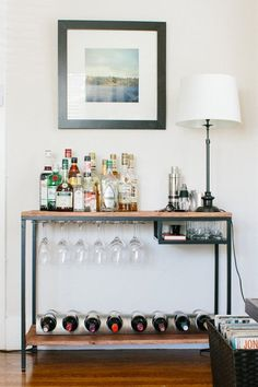 DIY Storage Idea for Wine & More | Get your bar carts, liquor cabinets, and wine racks ready for holiday guests with DIY liquor and wine storage options. These barcarts are the cutest!