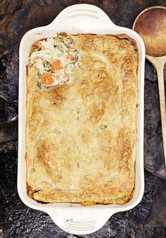 Straightforward and wonderfully homey, this chicken pot pie recipe is a classic that you'll keep coming back to. It starts with a thick and bubbly base made with shredded, roasted chicken; chopped red bell pepper; shallots; milk and cream. In goes some dry white wine, peas, carrots and potatoes; then you cover the mixture with puff pastry and bake. Simple and satisfying, this one never disappoints.
