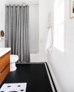 A classic bathroom is create with iconic manhattan subway tile. Yellow Bathroom Decor, Yellow Bathrooms, Silver Bathroom, White Bathroom, Master Bathroom, Bathroom Renos, Bathroom Flooring, Bathroom Ideas, Bathroom Designs