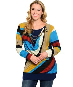 This top has a chain accent at the neckline and a button collar accent. The bold colors make it a perfect for work and play.