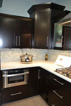 New Kitchen Dark Cabinets dark stained kitchen cabinets with contrasting light granite