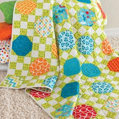 """This pattern is included FREE on the packaging of the die GO! Snowball-6"""" Finished (55330)Some blocks were just meant to be together. That's how we feel about the Snowball and the 9-Patch. This scrappy quilt is a great way to use your scraps.  What's stopping you from trying GO! Stoplights Quilt?Compatible with these fabric cutters:GO!      Studio**Must use with GO! Die Adapter"""