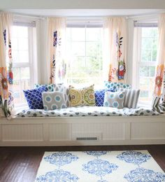 Window treatments for bay windows with window seat and flower curtains