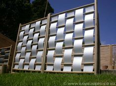 Something like this could be cute for a deck privacy screen. Perhaps use canvas and metal pipes?