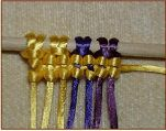 this site has excellent pictures to accompany their instructions on basic knots
