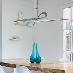 With graceful curves reminiscent of the trails seen on Vermont ski slopes, Hubbardton Forge's Switchback Pendant pairs LED technology with hand-forged steel to