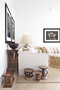 African art pieces and furniture makes this simple living room unique @pattonmelo