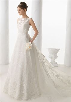 A classic A-line wedding dress, lace bateau neckline overlaying a sweetheart bodice. low cut V-back and the billowing detachable chapel-length lace train.