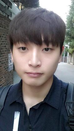 A typical Korean guy look. Single eye lid, tall nose and front comb hair. Simple yet girls like it a lot