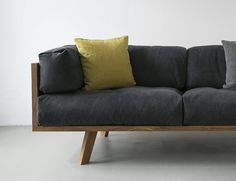 As the name suggests, this modern and minimalistic sofa is made from solid oak wood and natural linen