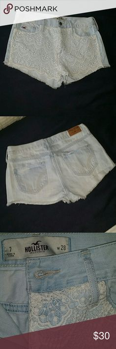 Hollister High Waisted Crochet Shorts High waisted shorts from Hollister. Very light blue denim with white crochet overlay on the front. Size 7, waist 28. Light distressed detail, small fray on the hem. Very gently worn, no signs of wear, great condition. Only issue is a crease in the back right pocket that could be ironed out and reformed with wear. Hollister Shorts Jean Shorts