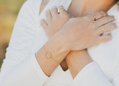 Mejuri x Jen Chae Grace collection. stackable rings, bracelet made in gold vermeil on sterling silver with white sapphires. chain ring made in solid 14k gold with a white sapphire. made for everyday, and for forever.