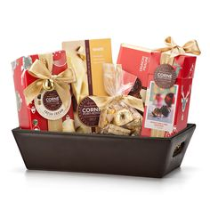 Send sweet holiday wishes with a Corné Port-Royal Belgian chocolate gift basket. This indulgent holiday chocolate hamper is the perfect chocolate office gift for Christmas.