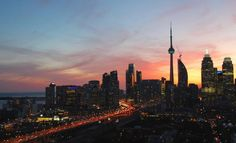 View of the sunset from a high-rise in the Distillery District, image by UrbanToronto Forum contributor Razz Cn Tower, New York Skyline, Sunrise, Cruise, Urban, Island, Vacation, City, Downtown Toronto
