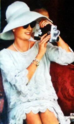 Princess Grace in a scalloped, short, scoop-necked dress & sweet wide-brimmed hat..simple pearls & fully engaged in the activities....effortlessly lovely.