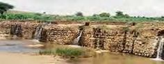 Bandhara -- traditional water harvesting system of storing rain water in Western India.These are useful for preventing ingress of saline water.