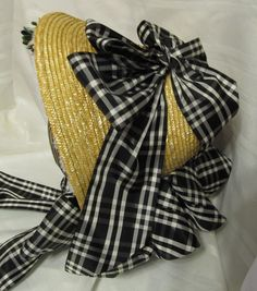 Straw bonnet with black and white plaid ribbon, bavolet and velvet flowers. By Anna Worden Bauersmith.