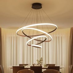 Our balancing halo hanging lamp is an incredible addition to any room of your living space. It challenges traditional chandelier design in every aspect possible. You likely won't see this design elsewhere, if at all. Chandelier In Living Room, Living Room Lighting, Modern Chandelier, Chandelier Lighting, Chandeliers, White Pendant Light, Cheap Pendant Lights, Modern Pendant Light, Conkers