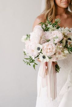 I like the greenery and texture in this bouquet. I would like the peonies to be a little bit more pink so they don't all look white.
