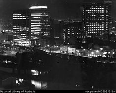 Sievers, Wolfgang, 1913-2007. Melbourne view across the Yarra to CBD and railway line with Flinders Street in the foreground : from left to right, William Street, Market Street (old customs house in between) and Queen Street, 1967 [picture]