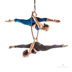 Oooo, this is contortion splits in and under the hoop. I like this move and this would be fun. I can actually do this move.