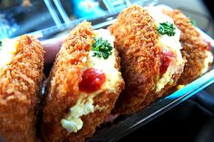 Japan Croquette Sandwich Potato croquette sliced and filled with tuna, egg,or ham salad