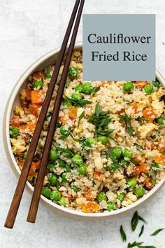 Healthy Cauliflower Fried Rice made with cauliflower, frozen vegetables, onion, garlic, ginger, eggs, soy sauce, and sesame oil! This low-carb stir-fry recipe is super easy to make and takes just 20 minutes to throw together. Use whatever veggies you have on hand, leave it vegetarian, or add in your favorite protein. Chicken, shrimp or beef would all be great in this!