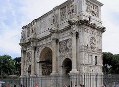 The Arch of Constantine  is a triumphal arch in Rome, situated between the Colosseum and the Palatine Hill. It was erected by the Roman Senate to commemorate Constantine I's victory over Maxentius at the Battle of Milvian Bridge in 312.  Dedicated in 315, it is the largest Roman triumphal arch. The arch spans the Via triumphalis, the way taken by the emperors when they entered the city in triumph.