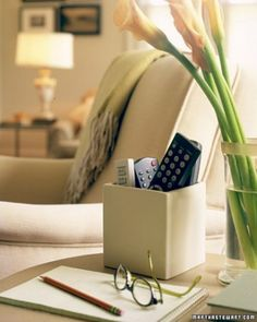 Use a low, wide vase to corral remote controls. Love this idea.