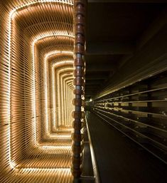 Huge glowing baskets surround the staircases of this former slaughterhouse in Madrid that Spanish architects Churtichaga + Quadra-Salcedo converted into a cinema.