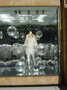 Love the reflectiveness on the balls in the window.  Looks very holiday.