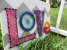 Bright Colorful String Art Love Sign. Pink, Blue, Purple, Yellow, Orange, Red String Art