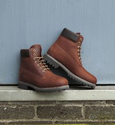half off 22790 e840d Timberland embraces their heritage with these brown 6 Inch Premium boots.
