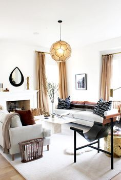Geometric light fixture in warm and neutral living room