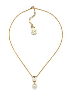 Our pearl and crystal pendant necklace features a 10k gold chain with a white or silver pearl suspended from a bar-shaped crystal. $13.99 for a limited time!