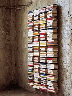 LOVE! #book shelves #displaying books- I want to do this with my DVD's or going around the perimeter of the our bedroom