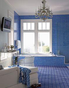 Beach House Bathroom with Chaise & Mirrored Vanity.
