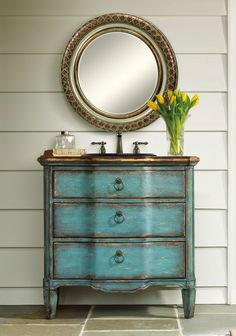 Designed to transform your room aesthetically and functionally, the Buckner Hall Chest has an Old World French appeal. Handpainted in turquoise with gold leaf edging, it derives much of its charm from