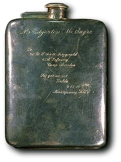 F. Scott Fitzgerald's flask. Engraving reads: To 1st Lt. F. Scott Fitzgerald, 65th Infantry, Camp Sheridan, Forget-me-not, Zelda, 9-13-18, Montgomery, Ala.