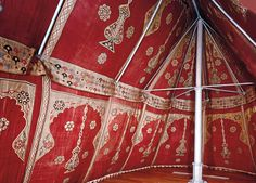 Repeating rosettes, arches and images of hanging lamps decorate the interior of this 17th-century Ottoman tent. Real lamps would have been hung from the ridgepole. The tent was doubtless meant for an aristocrat or high-ranking administrator.