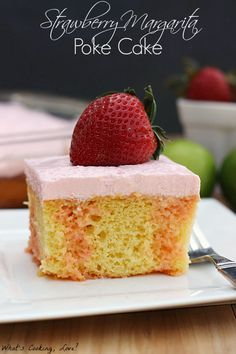 Strawberry Margarita Poke Cake.  A delicious and moist cake filled with the flavors of lime and strawberry and topped with strawberry and lime flavored whipped cream.  #cake #dessert #strawberrymargarita