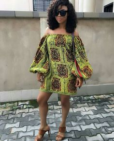 Nigerian Wedding Popular Ankara Styles: Check Out These 35 Stylish Ways To Rock The Off Shoulder Ankara Exaggerated Balloon Sleeves Tops African Dresses For Women, African Print Dresses, African Attire, African Wear, African Fashion Dresses, African Women, African Prints, African Style, African Inspired Fashion