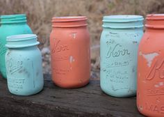 SALE Teal, Turquoise, Aqua, and Coral Painted Mason Jars - Set of 12 - Coral and Teal Decor - Coral and Turquoise Decor. $70.00, via Etsy.