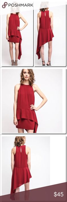 """Ali &Jay Side Drape Mini Dress in Red Details Romantic and unexpected, this side drape mini dress by Ali & Jay is understated and unique in its flowing side accent, tiered skirt, and pop of color. It's saying so much by saying so little, you know?   Side drape mini dress Tiered skirt Hi-neck Keyhole back detail Red Interior lining 100% polyester Dry clean only Measures approximately 33"""" from shoulder (mini dress), 55"""" (drape accent) Model shown wearing size small (S) ali & Jay Dresses Mini"""