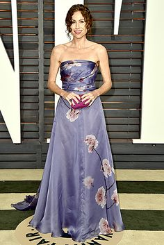 Minnie Driver embraced flower power in a lavender Pamella Roland dress boasting a cherry blossom print. A berry clutch paired with a romantic updo finished the outfit.