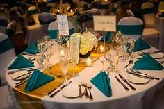 Details for a teal and gold wedding reception tablescape. Use teal napkins, a gold table runner with white tablecloths and white spandex chair covers so the colors are more accents then main feature. Teal Centerpieces, Gold Wedding Decorations, Wedding Themes, Wedding Colors, Wedding Ideas, Trendy Wedding, Wedding Stuff, Teal Gold Wedding, Dark Teal Weddings