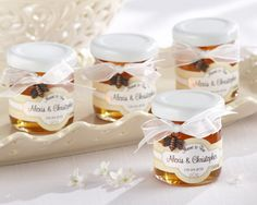 Wedding Favors Personalized Honey Bee Charm Jars Wedding favors personalized meant to bee clover honey party favor gifts.  Sold in sets of 12 personalized favors. Minimum order is 2 sets (24 favors) Kisses sweeter than honey--especially that single most important kiss on your day of days!